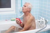 Senior man bathing — Stock Photo