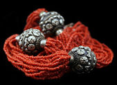 Coral and silver necklace — Stock Photo