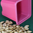 Pink pot with seeds — Stock Photo