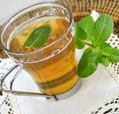 Cup of mint tea with a sprig of min — Stock Photo