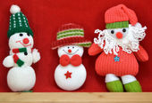 Three snowmen santa on red background — Stock Photo