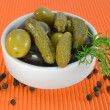 Pickles and olives pickled in white bowl — Stock Photo