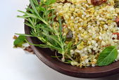 Prepared rice with herbs and curry — Stock Photo
