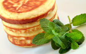 Pancakes with  mint leaves — Stock Photo