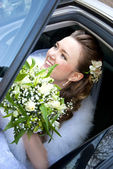 Bride in the car — Stock Photo