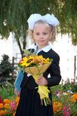 Schoolgirl in elementary school — Stock Photo