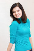 Beautiful brunette girl smiling cheerfully — Stock Photo