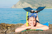 Happy young diver on the sea beach — Stock Photo