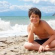 Happy smiling boy on the sea beach — Stock Photo