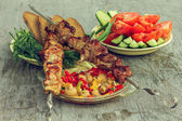 Stillife with holiday makers menu skewers with vegetables — Stock Photo