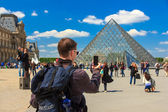 Louvre Museum and the Pyramid in Paris, France — Stock Photo