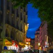 Montmartre by night - shopping street near Sacre Coeur — Stock Photo #47807505