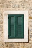 Green window on the wall — Stock Photo