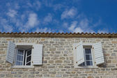 The windows on the facade of stone House — Stock Photo