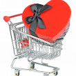A love heart gift box in a shopping cart — Stock Photo
