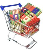 A shopping trolley cart with Christmas gifts — Stock Photo