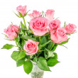 A bunch of pink roses in a glass vase — Stock Photo