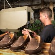Adult man working in a shoe factory — Stock Photo #14068626