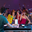 Party of young peopple, with dj, present and paty horns - Stock Photo