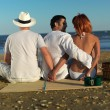 Woman cheating on boyfriend by sea shore — Stock Photo