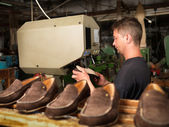 Adult man working in a shoe factory — Stock Photo