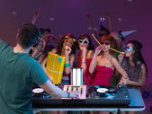 Party of young peopple, with dj, present and paty horns — Stock Photo