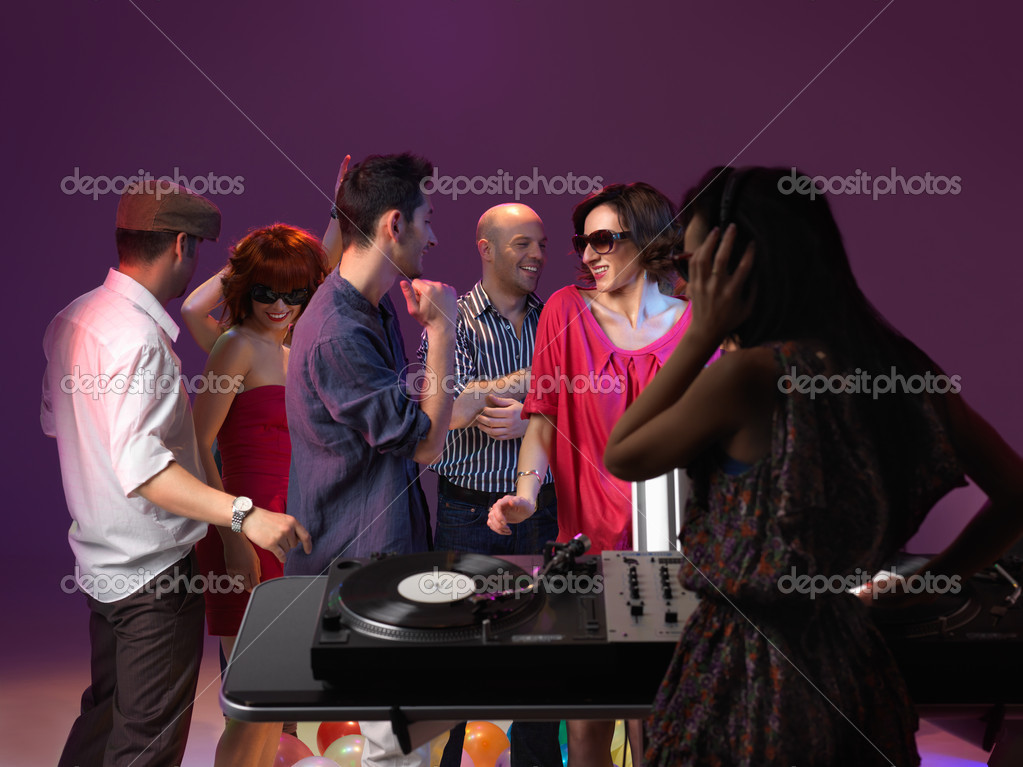 Young dancing and smiling, with dj mixing — Stock Photo #14068655