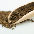 Wooden spoon cumin - Stock Photo