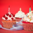 Three vibrant surprise muffins - Stock Photo