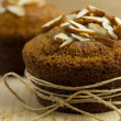 Almond muffin wrapped up as a gift — Zdjęcie stockowe