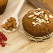 Stock Photo: Breakfast muffin with almonds and redcurrants