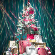 Colorful christmas tree with lights - Stock Photo