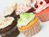 Multicolor cupcakes — Stock Photo