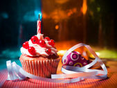 Surprise cupcake with candle — Stock Photo