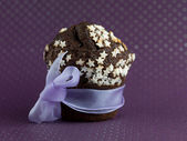 Chocolate muffin wrapped up as a gift — Stock Photo