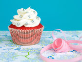 Red colored cupcake with vanilla frosting — Stock Photo