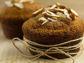 Almond muffin wrapped up as a gift — Stok fotoğraf