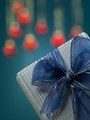 Tiny present with bow and glitter — Stock Photo