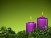 Holiday purple candles — Stock Photo