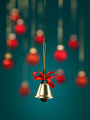 Golden christmas jingle bell — Stock Photo