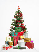 Christmas tree with colorful presents — Stock Photo