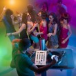 Young dancing at party with dj — Stock Photo #19986613