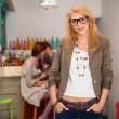 Young caucasian blonde girl in cafe — Stock Photo