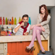 Young couple in colorful cafe — Stock Photo