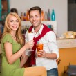 Young casual couple drinking cocktails — Stock Photo