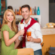 Stock Photo: Young casual couple drinking cocktails