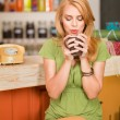Gorgeous girl drinking coffee - Stock Photo