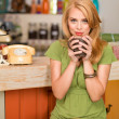 Beautiful girl drinking coffee - Stock Photo