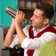 Stock Photo: Hadsome bartender preparing drink