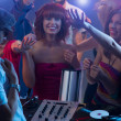 Stock Photo: Young attractive girl laughing at party with dj